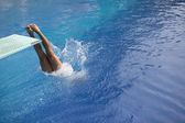 Swimmer diving into a pool — Stock Photo