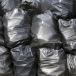 Black trash bags — Stock Photo