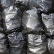 Black trash bags — Stock Photo #24821723
