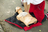 CPR training - heart massage — Stock Photo