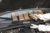 Hidden drugs in a vehicle compartment — Stock Photo