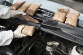 Drug smuggled in a car's engine compartment — Stock Photo