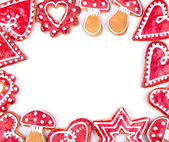 Gingerbread cookies and spices over white background close up — Stock Photo