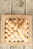 Walnuts on a wooden board — Stockfoto