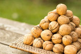 Walnuts on a wooden board — Foto Stock