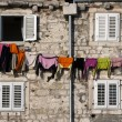 Clothes on the line between four windows — Stock Photo