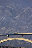Maslenica bridge in front of mountain Velebit — Stock Photo