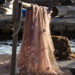 Stock Photo: Red fishing net on beam