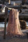 červené rybářské sítě na paprsku — Stock fotografie