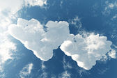 Two cloudy hearts on the lovely sky background — Stock Photo
