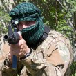 Armed terrorist, freedom fighter, a masked killer — Stock Photo #22525351