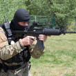 Armed terrorist, freedom fighter, a masked killer — Stock Photo #22525851