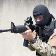 Armed terrorist, freedom fighter, a masked killer - Stock Photo