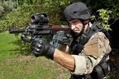 "Special Forces soldier with an assault rifle ""sa.58"" — Stock Photo"