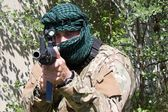 Armed terrorist, freedom fighter, a masked killer — Stock Photo