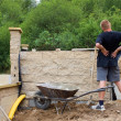 Stock Photo: Back pain, bricklayer builds wall