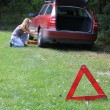 Young blond girl puncture repairs — Foto de Stock