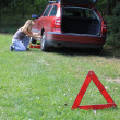Young blond girl puncture repairs — Stockfoto