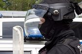 Police officer in a protective helmet and visor, preparation for the demonstration — Stock Photo