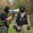 Military instructor yells at novice, hard training, communication - Stock Photo