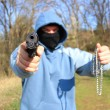 Masked robber with a weapon, assault - Stok fotoğraf