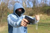 Masked robber with a weapon, assault — Stock Photo