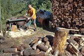 Man cutting firewood, preparing for winter — Stock Photo