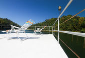 Resting chair on top of houseboat — Stockfoto