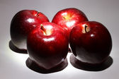 Red apples in low light — Stock Photo