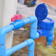 Stock Photo: Water valve connects to PVC pipe.