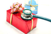 Red gift box and a stethoscope — Stock Photo