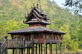 Ancient wooden budhist scriptures hall in the pond at Thai, Nakh — Stock Photo