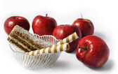 Apples and cakes — Stock Photo