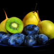 Fruits on black — Stockfoto