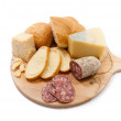 Cutting board with bread, cheese and salami - Stock Photo