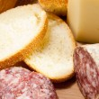 Cutting board with bread, cheese and salami — Foto Stock