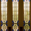 Series of stained glass windows leaving a colourfull pattern — Stock Photo