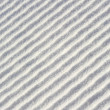 Diagonal waves (or ridges) in snow — Stock Photo