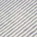 Diagonal waves (or ridges) in snow — Stock Photo