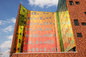 Office building with colourfull reflexions in windows — Stock Photo