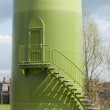 Stock Photo: Base of windturbine with stairs and entrance door.