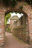 Historic gate and alley — Stock Photo