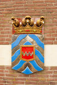 Ancient shield of former polder district — Stock Photo