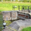 Doors of sluice in water barrier — Stock Photo