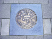 Coin of five cents in pavement — Stock Photo