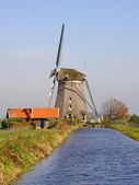 Traditional Dutch wind mill in channel — Stock Photo