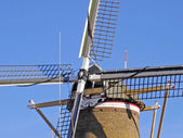 Windmill cross with stacked sails — Stock Photo