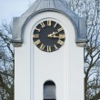 Stock Photo: White Church tower belfry clock weathercock