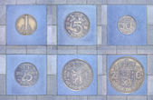 Collection of former Dutch coins in pavement — Stock Photo