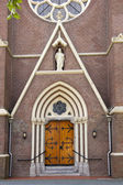 Decorative entrance door of church — Stock Photo